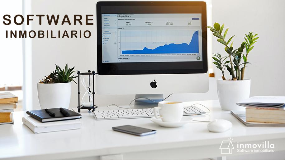 Imagen de un escritorio con un MAC que tiene una imagen de un software CRM Inmobiliario